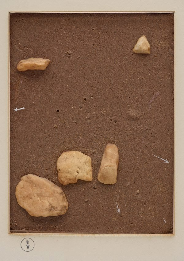 An image of Stones staring at the ground (anywhere)