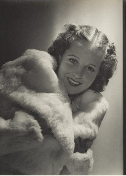 An image of Untitled (fashion illustration - woman in fur coat) by Max Dupain