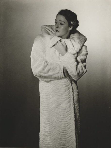 An image of Untitled (fashion illustration: model in a white coat) by Max Dupain