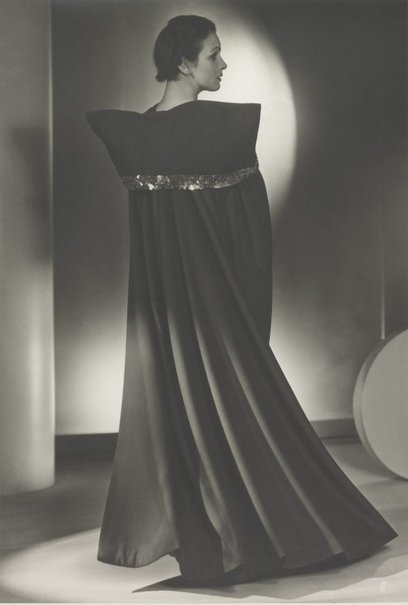 An image of Untitled (fashion illustration: models in a cape) by Max Dupain