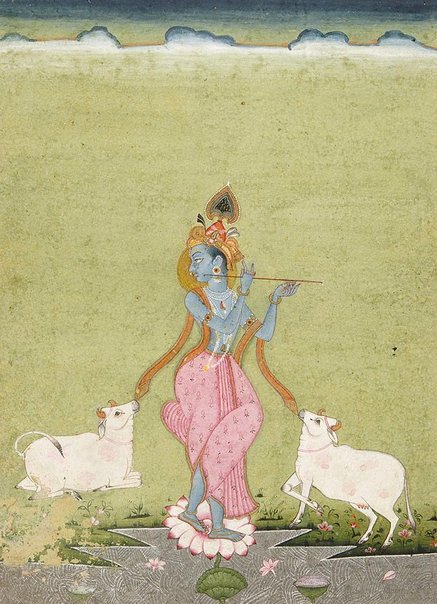 An image of Krishna as the divine cowherd (orange border) by