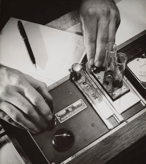 An image of Untitled (hands operating a Lumetron Colorimeter) by Max Dupain
