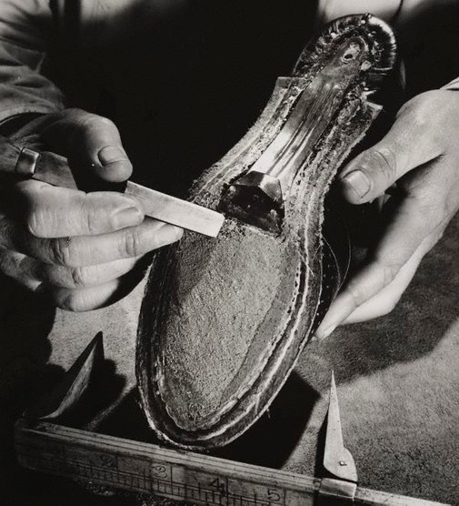 An image of Untitled (shoemaker) by Max Dupain