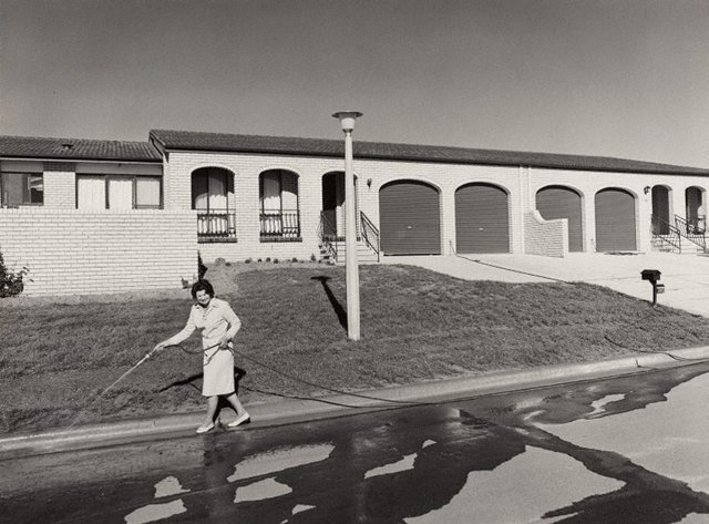 An image of Woman hosing, Canberra