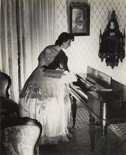 An image of recto: Untitled (Victorian interior with woman at clavichord) verso top: Untitled (watchmaker) verso bottom: Untitled (woman in wireless advertisement) by Max Dupain