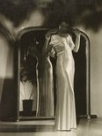 Alternate image of recto: Untitled (cutting English FINTEC) verso: Untitled (woman looking down in white nightgown in front of mirror) by Max Dupain