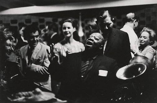 An image of U.S. blues singer, Jimmy Rushing singing at Kym Bonython's house, Grange S.A. by Robert McFarlane