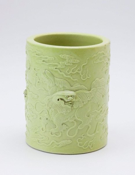 An image of Brush pot decorated with male Buddhist lion, two puppies and a bat by