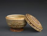 Alternate image of Footed jar with lid and carved decoration, as well as floral and geometric patterning by Sawankhalok ware