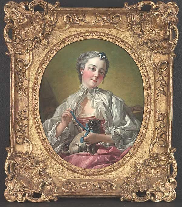 An image of A young lady holding a pug dog