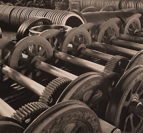 An image of Wheels, Commonwealth Steel Company B.H.P.(Despatch bay, tram wheels and axles) by Harold Cazneaux
