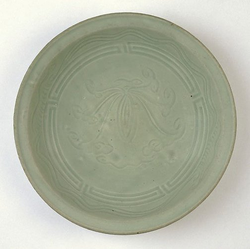 An image of Dish with incised waves and lotus design by Hasami ware