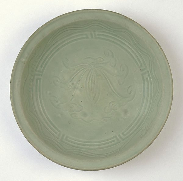 An image of Dish with incised waves and lotus design