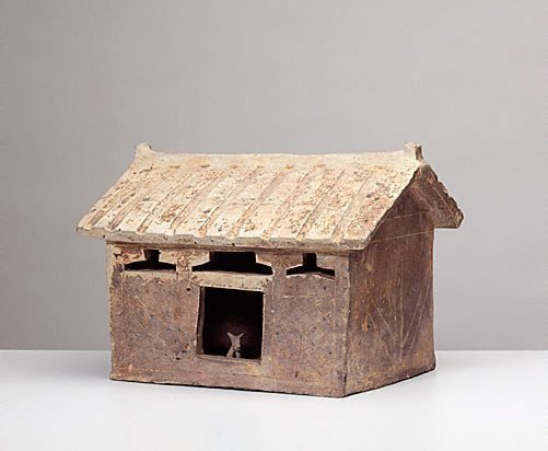 An image of Model of a house [with a dog inside the house] by