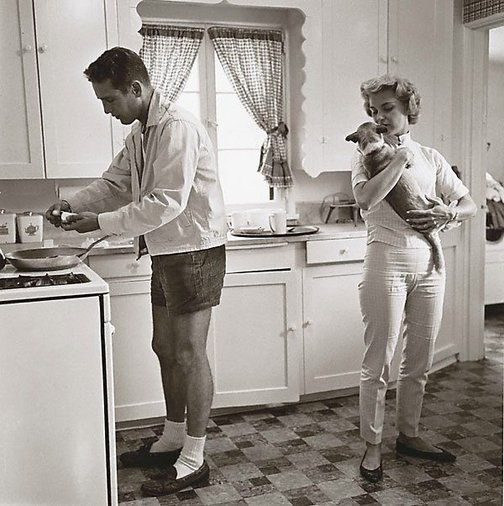 An image of Paul Newman and Joanne Woodward in their kitchen photo taken at their Beverly Hills home in 1958 for the Saturday Evening Post by Sid Avery