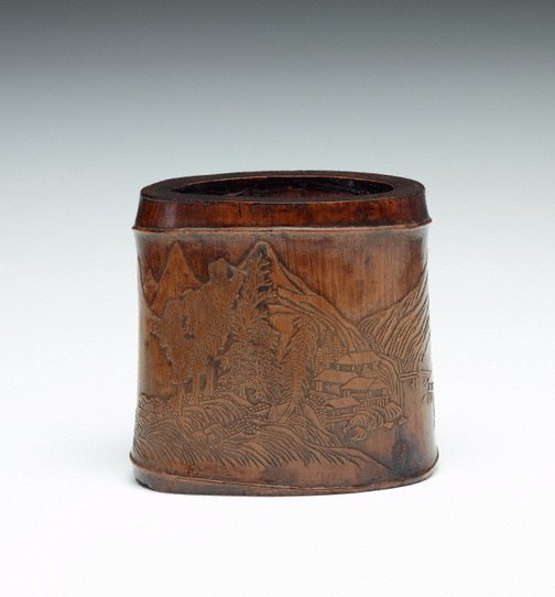 An image of Bamboo brush pot decorated with landscape and pavilion in low relief by