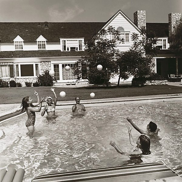 An image of Award winning lyricist, Sammy Cahn, his wife, Gloria, their children, Stephen 12, Lori 10, and a friend play in the pool at their Los Angeles Home. Photo was taken in 1959 for the Saturday Evening Post