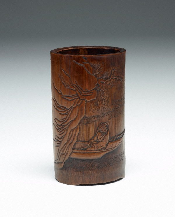 An image of Bamboo brush pot decorated with a bearded man in a boat and a poem in low relief