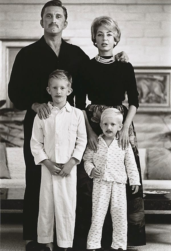 An image of The Douglas family portrait, Kirk, his second wife Anne, and their two sons, Peter Vincent and Eric Anthony. Photographed at their Beverley Hills home