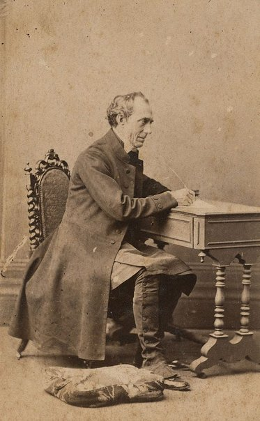 An image of Untitled (portrait of a man seated at desk) by Unknown photographer