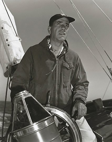 "An image of Humphrey Bogart at the helm of his 55 foot yacht ""Santana"""