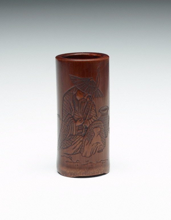 An image of Bamboo brush pot decorated with engraving of a bearded man holding a fishing rod