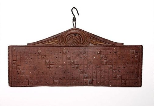 An image of Carved wooden Balinese calendar ('tika') by