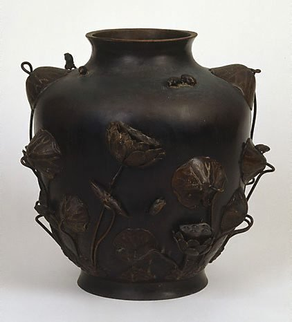 An image of Large vase decorated with sculptured lotus and frogs and incised water pattern and water plants by Meiji export crafts