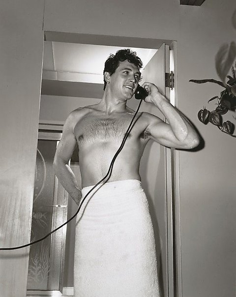 An image of Rock Hudson photographed at his Hollywood Hills home by Sid Avery