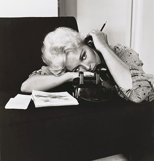 An image of Kim Novak, talking on the phone at her home in Los Angeles, CA