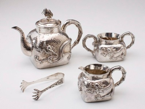 An image of Tea service, comprising teapot, creamer, sugar bowl and tongs by Unknown