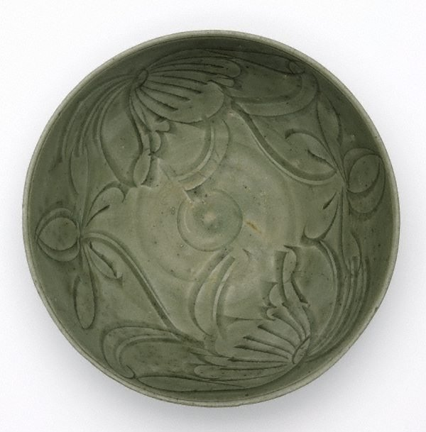 An image of Celadon bowl with carved floral design