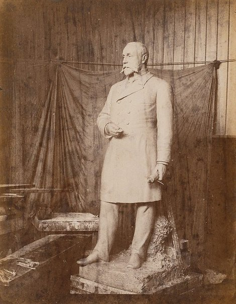 An image of Untitled (sculpture of a man standing holding a rolled document in left hand) by Unknown photographer
