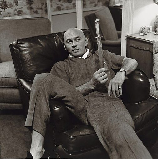 An image of Brynner contemplates a prop knife from his film 'The King and I' by Sid Avery