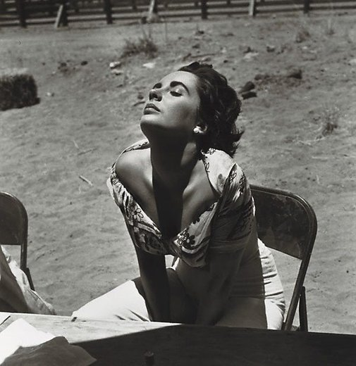 "An image of Elizabeth Taylor sunning herself on the Marfa, Texas set of ""Giant"" by Sid Avery"