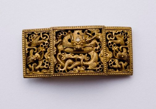 An image of Gold dragon belt buckle by