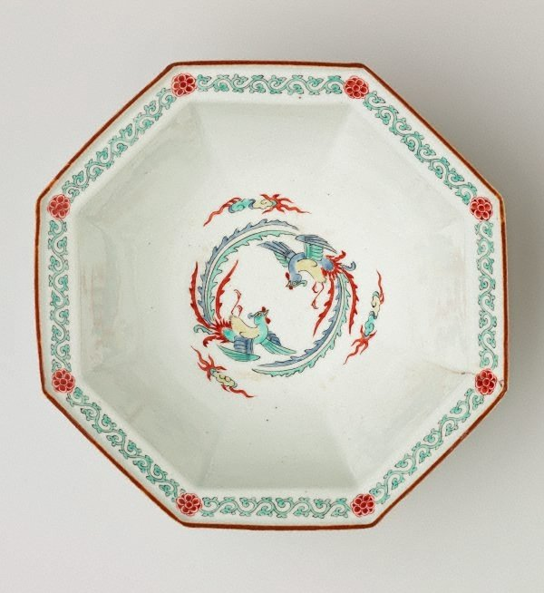 An image of Octagonal bowl with design of two phoenixes on the interior and pine and flowering plum trees on the exterior