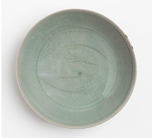 An image of Dish with incised design of two birds, probably parrots by