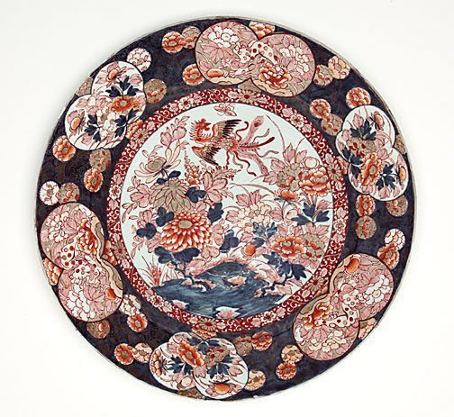 An image of Large charger with design of phoenix and flowering plants in the centre and flower and animal pattern around it