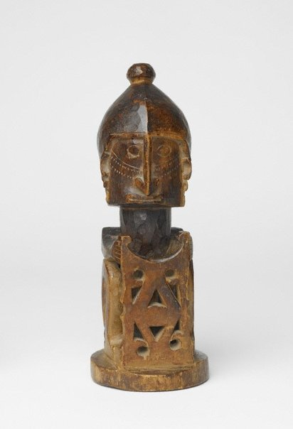 An image of Seated figure holding a shield ('korvar') by