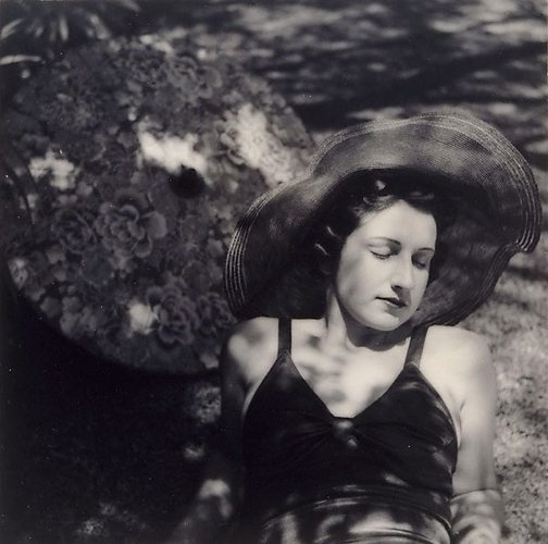 An image of Untitled (Woman in sun hat with parasol) by William Buckle