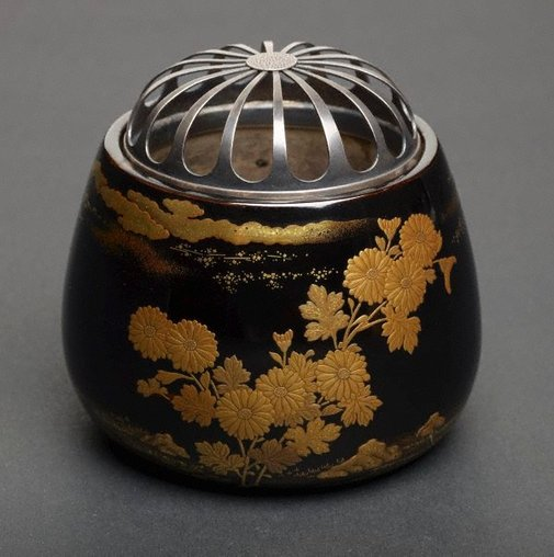 An image of Incense burner with design of chrysanthemum and open work silver lid by