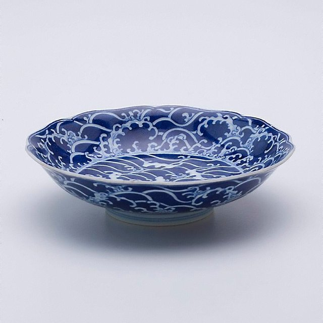 An image of Dish with sea and rock motifs
