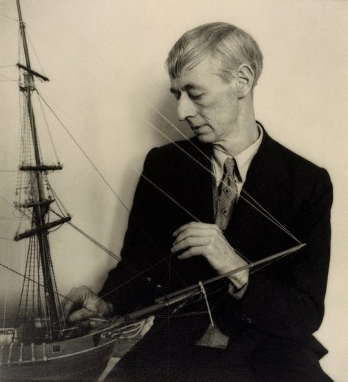 An image of Norman Lindsay (with model ship - close up) by William Buckle