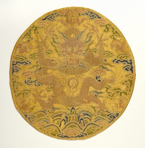 An image of Front facing dragon roundel with imperial yellow background by
