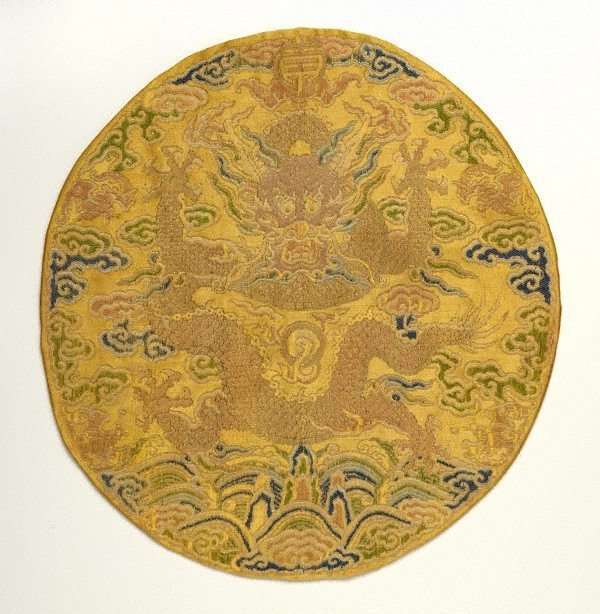 An image of Front facing dragon roundel with imperial yellow background