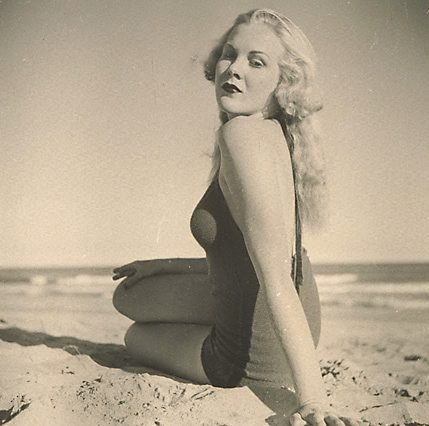 An image of Untitled (Blonde woman on beach in swimsuit)
