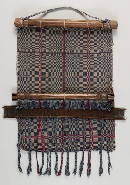 An image of Back-strap loom with section of blanket [owes] by Itneg