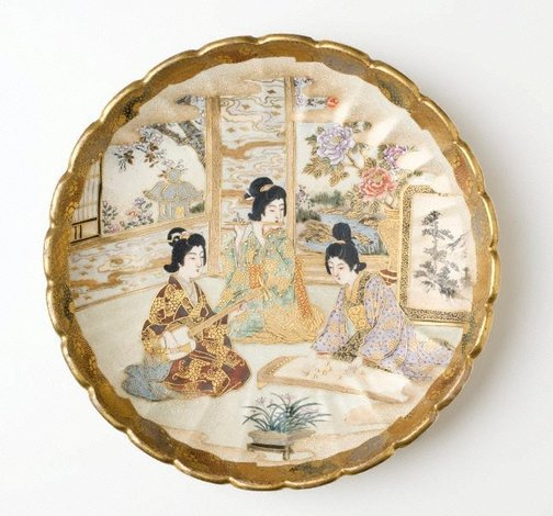 An image of Plate with design of three women playing musical instruments by Satsuma ware, Hodota