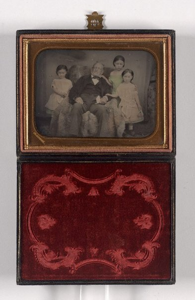 An image of Untitled (portrait of a man and three girls) by Glaister studio